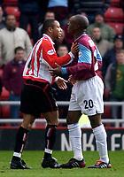 Photo. Glyn Thomas.<br /> Sunderland v West Ham United.<br /> Nationwide Division 1.<br /> Stadium of Light, Sunderland. 13/03/2004.<br /> West Ham's Nigel Reo-Coker (R) has a dispute with Jeff Whitley.