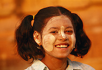 """Girl in Bagan with her face covered in thanaka paste to cool and protect her skin.<br /> Available as Fine Art Print in the following sizes:<br /> 08""""x12""""US$   100.00<br /> 10""""x15""""US$ 150.00<br /> 12""""x18""""US$ 200.00<br /> 16""""x24""""US$ 300.00<br /> 20""""x30""""US$ 500.00"""
