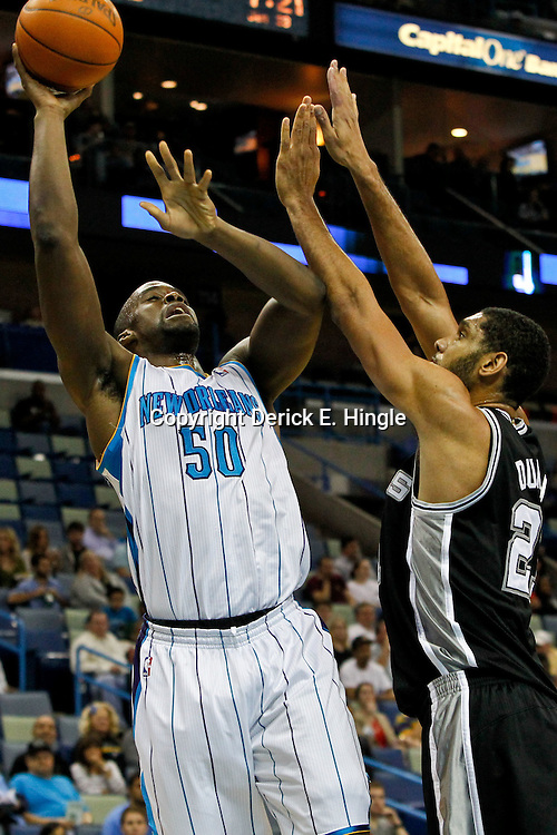 January 23, 2012; New Orleans, LA, USA; New Orleans Hornets center Emeka Okafor (50) shoots over San Antonio Spurs center Tim Duncan (21) during the first quarter of a game at the New Orleans Arena.   Mandatory Credit: Derick E. Hingle-US PRESSWIRE