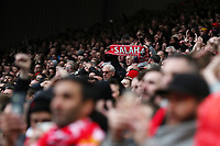 Football - 2018 / 2019 Premier League - Liverpool vs. Chelsea<br /> <br /> A Liverpool fan holds up a Mohamed Salah scarf, at Anfield.<br /> <br /> COLORSPORT/PAUL GREENWOOD