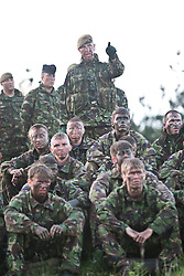 Captain Stewart Bridgehouse of the Scots Guards Regimental Support Team, middle with beret, with the soldiers trying army life, Setting up the night exercise..Exercise Guards Warrior with the Scots Guards at their Catterick base..Pic ©2010 Michael Schofield. All Rights Reserved.