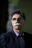 Persian-Dutch writer Kader Abdolah, pictured at the Edinburgh International Book Festival where he talked about his new novel entitled 'The King'. The three-week event is the world's biggest literary festival and is held during the annual Edinburgh Festival. The 2014 event featured talks and presentations by more than 500 authors from around the world and was the 31st edition of the festival.