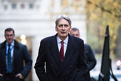 © Licensed to London News Pictures. 28/11/2017. London, UK. The Chancellor of The Exchequer Philip Hammond arrives on Downing Street for the weekly Cabinet meeting. Photo credit: Rob Pinney/LNP