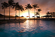 A guest swims in the oceanside swimming pool at the Turtle Bay Resort on the North Shore of Oahu, Hawaii