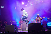 Beres Hammond jumping at The Biolife Sounds of Reggae at the Barclays Center.