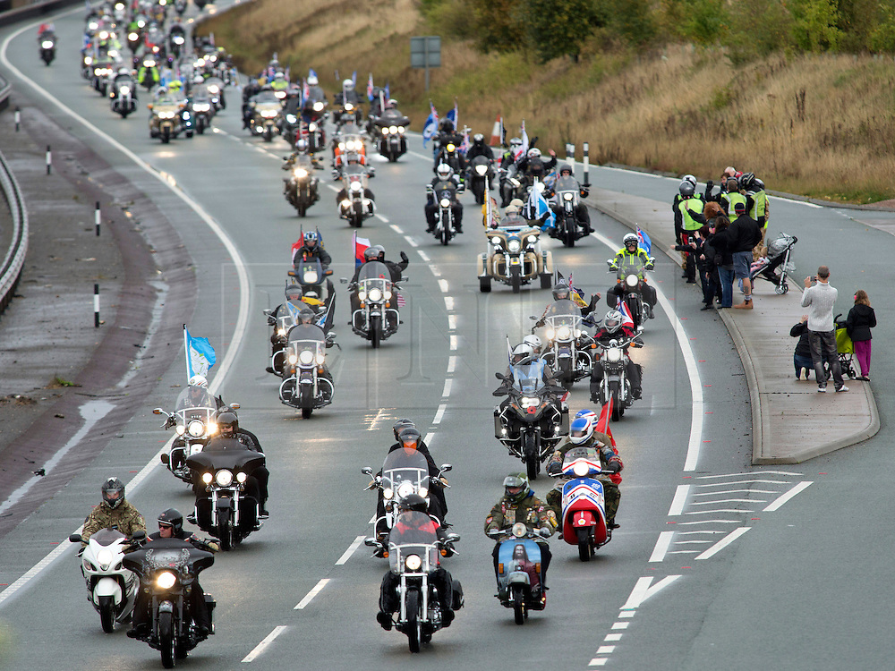 © Licensed to London News Pictures. 04/10/2014. Alrewas, Staffordsire, UK. The 2014 Ride to the Wall took place today. Over six thousand riders started from six points to Ride To The Wall, at the National Memorial Aboretum in Staffordshire. The seventh time the event has taken place and has now become an annual pilgramage for ex-servicemen and those currently serving in the Armed Forces. Pictured, the riders make their way along the Tamworth by-pass near Hints. Photo credit : Dave Warren/LNP