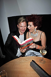 CLEO ROCCOS and HENRY CONWAY at the launch of Nicky Haslam's autobiography Redeeming Features held at Aqua Nueva, 240 regent Street, London on 5th November 2009.
