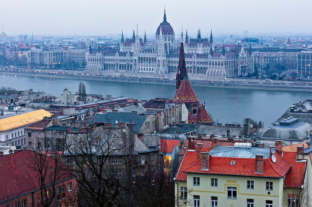 View of the Budapest Parliament at dusk, foggy day.