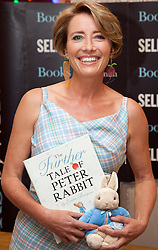 © Licensed to London News Pictures. 06/09/2012. LONDON, UK. Emma Thompson is seen wearing a couture gown featuring a bespoke 'Peter Rabbit' tartan designed by Maria Grachvogel at Selfridges Oxford Street store in London today (06/09/12).  The actress appeared at the shop to sign copies of her new book 'The Further Tale of Peter Rabbit'. Photo credit: Matt Cetti-Roberts/LNP