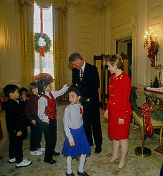 December 21, 1993 - Washington, District of Columbia, U.S - First Lady Hillary Rodham Clinton and President William Clinton host the United Nation children in the East Room of the White House for a Christmas reception  (Credit Image: © Mark Reinstein via ZUMA Wire)