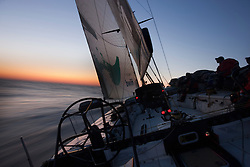 Stockholm/Saint Petersburg, June 25th- June 27th 2009. Green Dragon during leg 10 of the Volvo Ocean Race (25/27 June 2009). <br /> <br /> The sun is setting on the Baltic sea as the crew is sitting on the sails on the windward rail. This is one of my more memorable moments as I had the privilege of sailing the last leg of the Volvo with the Green Dragon. The weather didn't really gave me the extreme experience I hoped for, but the short night and long sun hours made for some nice conditions after all.