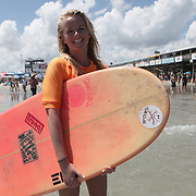 A competitor is seen during the 28th annual National Kidney Foundation, Rich Salick Pro/Am surf festival takes place at the the Cocoa Beach pier on Saturday,  September 2, 2013 in Cocoa Beach, Florida. This event raises thousands of dollars for people with kidney disease and also benefits the services of the NKF of Florida. (AP Photo/Alex Menendez)