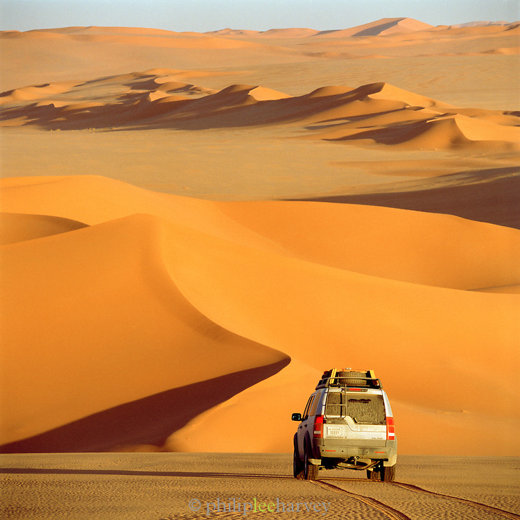 4x4 off-road vehicle heading off into the Sahara Desert, Libya