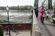 After being closed indefinitely to all traffic due to structural faults, friends chat on Hammersmith Bridge, on 11th April 2019, in west London, England. Safety checks revealed critical faults and Hammersmith and Fulham Council has said its ben left with no choice but to shut the bridge until refurbishment costs could be met. The government has said that between 2015 and 2021 its is providing £11bn of support to the 132-year-old bridge.
