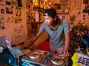 28 JANUARY 2016 - BANGKOK, THAILAND: Go, the owner of 23 Bar and Gallery in Bangkok spins music from behind the bar.        PHOTO BY JACK KURTZ