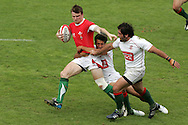 Craig Hill of Wales tries to break free from the Portuguese tackle. IRB Emirates airline Dubai sevens 2008. match 35 action, Bowl semi  final between  Wales and Portugal  at the Sevens Stadium in Dubai on Sat 29th November 2008..pic by Andrew Orchard.