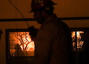 Flames from the Blue Cut wildfire is reflected at windows near Cajon Pass, north of San Bernardino, Calif., August 16, 2016. The fire is currently 9,000 plus acres, with 700 personnel on scene. Fifty-seven engines, 8 crews, 8 air tankers, 2 Very Large Air Tankers (VLATS), with additional firefighters and equipment on order. There is imminent threat to public safety, rail traffic and structures. With this being a very quickly growing wildfire, evacuation instructions have been issued. An estimated 34,500 homes and 82,640 people are being affected by the evacuation warnings.  AFP PHOTO / Ringo Chiu