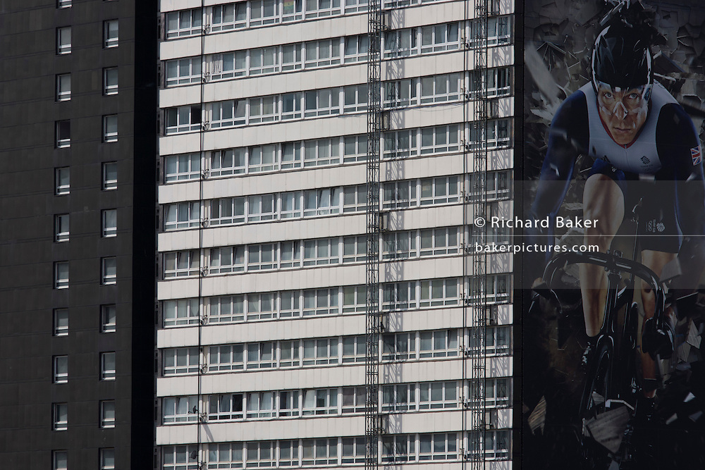 An image of British sprint cycling hero and 5-times Gold medallist, Sir Chris Hoy appears on the side of a tower block that overlooks the Olympic Park, seen during the London 2012 Olympics, the 30th Olympiad. Hoy is endorsing the Gillette brand whose slogan is 'Nothing Beats a Great Start' and is seen on his Team GB track bike.