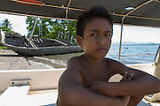 Siti Rofi'ah's step grandson Mohamad, 6, poses for a photograph on the beach of Lewoleba, Nubatukan subdistrict, Lembata district, East Nusa Tenggara province, Indonesia.