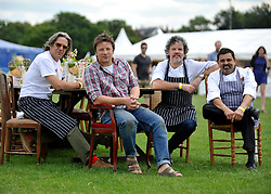 © licensed to London News Pictures. LONDON. UK.  01/07/11. Jamie Oliver arrives at the festival in Clapham Common. Jamie Oliver's The Big Feastival, is a three day event featuring food from some of the country's top chefs along with live music. The Big Feastival takes place on Clapham Common on the 1st, 2nd and 3rd July. All profits from the event will be shared between The Jamie Oliver Foundation and The Prince's Trust.  Mandatory Credit Stephen Simpson/LNP