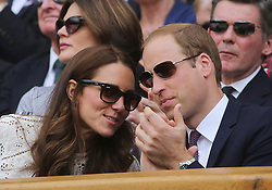 Image ©Licensed to i-Images Picture Agency. 02/07/2014. London, United Kingdom. The Duke and Duchess of Cambridge pull a face as Andy Murray is beaten by Grigor Dimitrov in the Men's  Quarter Finals on centre court in the Royal box at  Wimbledon. Picture by  i-Images