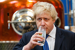 © Licensed to London News Pictures. 17/04/2015. LONDON, UK. Mayor of London and Conservative Party parliamentary candidate for Uxbridge and South Ruislip, Boris Johnson  sampling a glass of gin tonic during a visit to The Sipsmith Distillery in Chiswick, west London on Friday, 17 April 2015. Photo credit : Tolga Akmen/LNP