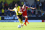 Burton Albion forward Marvin Sordell (17) and Scunthorpe United midfielder Matthew Lund (7) during the EFL Sky Bet League 1 match between Burton Albion and Scunthorpe United at the Pirelli Stadium, Burton upon Trent, England on 29 September 2018.