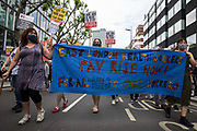 NHS workers and supporters take part in a protest march from University College Hospital UCH to Whitehall as part of a national day of action to mark the 73rd birthday of the National Health Service on 3rd July 2021 in London, United Kingdom. The protesters called for fair pay for NHS workers, for better funding of the NHS and for an end to privatisation measures affecting the NHS.