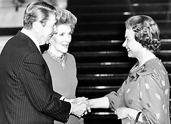 The Queen greets American President Ronald Reagan and First Lady Nancy Reagan at Buckingham Palace, where they met for tea. The President is in London for an overnight stop-over following a meeting with President Gorbachev in Moscow.