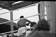Ali vs Lewis Fight, Croke Park,Dublin.<br /> 1972.<br /> 19.07.1972.<br /> 07.19.1972.<br /> 19th July 1972.<br /> As part of his built up for a World Championship attempt against the current champion, 'Smokin' Joe Frazier,Muhammad Ali fought Al 'Blue' Lewis at Croke Park,Dublin,Ireland. Muhammad Ali won the fight with a TKO when the fight was stopped in the eleventh round.<br /> <br /> Image shows Lewis trying to put up a defence as Ali drives forward.
