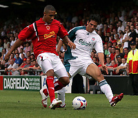 Photo: Paul Thomas.<br /> Crewe Alexandra v Liverpool. Pre Season Friendly. 22/07/2006.<br /> <br /> Mark Gonzalez of Liverpool (R) tries to tackle Jon Otsemobor.