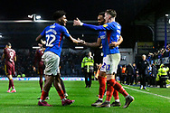 Ronan Curtis (11) of Portsmouth celebrates the 1-0 win at full time with Ellis Harrison (22) of Portsmouth and Anton Walkes (2) of Portsmouth during the EFL Sky Bet League 1 match between Portsmouth and Ipswich Town at Fratton Park, Portsmouth, England on 21 December 2019.
