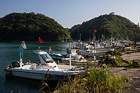 64.4.  Yunotsu Port & Townscape - 64.4. Yunotsu Onsen Townscape 温泉津 is found along the coast near Omori and is part of the historical landscape of Iwami Silver Mines. The town became active in the later part of the 16th century as the administrative center of Iwami Ginzan and its surrounding areas. Nearby ports were used for shipping the silver itself, which explains Yunotsu's prominence in the area.  The layout of the houses remains unchanged from the early Edo Period.  The retro architecture and classic onsen style town are the other draws.