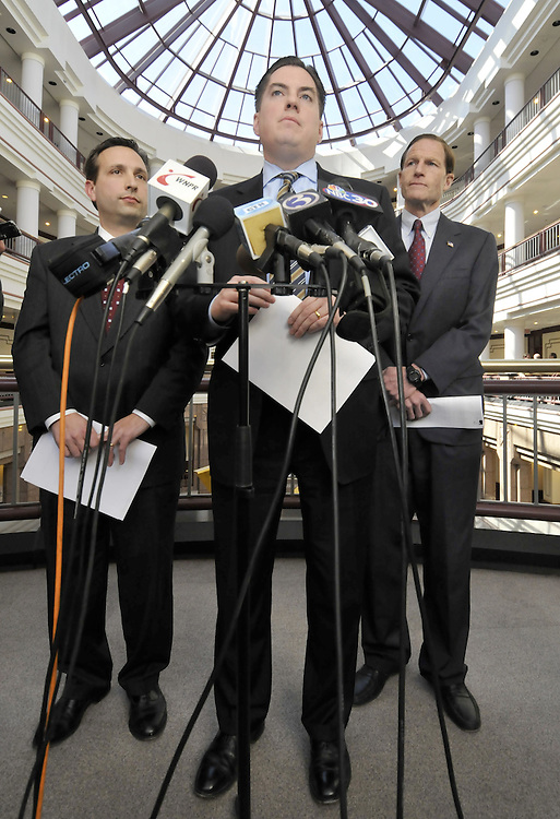 State Rep. Ryan Barry, D-Manchester, center, , state Sen. Bob Duff, D-Norwalk, left, and Connecticut Attorney General Richard Blumenthal, right,  discuss their talks with American International Group Inc. regarding legislative subpoenas to former and current AIG employees during a press conference at the Legislative Office Building in Hartford, Conn.