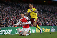 Andre Gray of Burnley pushes Laurent Koscielny of Arsenal to the ground. The Emirates FA cup, 4th round match, Arsenal v Burnley at the Emirates Stadium in London on Saturday 30th January 2016.<br /> pic by John Patrick Fletcher, Andrew Orchard sports photography.