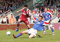 Photo: Steve Bond.<br /> Scunthorpe United v Carlisle United. Coca Cola League 1. 05/05/2007. Matt Sparrow (L) vaults over Danny Livesey (R)