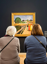 Two visitors looking at painting, The Girls on the Bridge, by Edvard Munch  at new Museum Barberini in Potsdam Germany