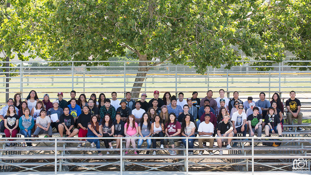 Calaveras Hills High School Class of 2014 poses for a class photo at the Milpitas Sports Center in Milpitas, California, on June 6, 2014. (Stan Olszewski/SOSKIphoto)