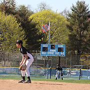Players and the outfield umpire prepare for a play during the Norwalk Little League baseball competition at Broad River Fields,  Norwalk, Connecticut. USA. Photo Tim Clayton