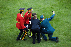 Guest take a picture as they attend at a garden party at Buckingham Palace in London.
