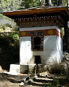 A small decorated building housing a water driven prayer wheel on the path to Paro Taktshang Goemba, the Tiger's nest. Paro Taktsang Bhutan, Druk Yul. 11 November 2007