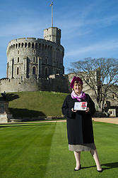 Dames Commander Dame Rosemary Squire of Pyrford, co-founder of the Ambassador Theatre Group Limited displays her award for theatre and services to philanthropy at an investiture ceremony at Windsor Castle, Berkshire. Windsor Castle, Windsor, February 16 2018.