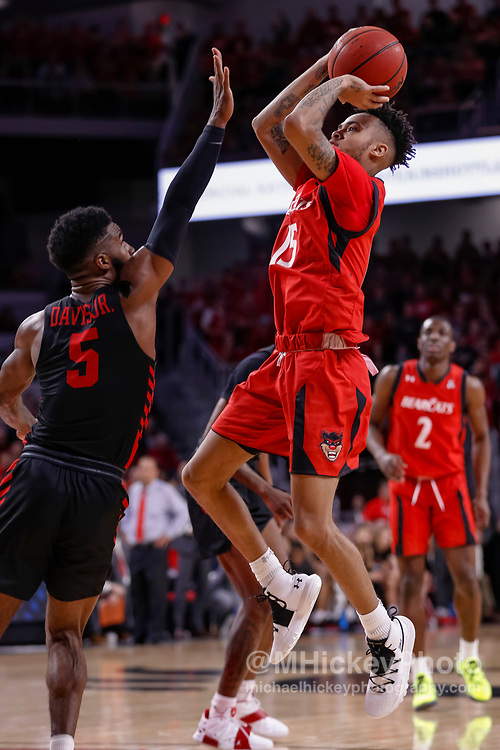 CINCINNATI, OH - MARCH 10: Nysier Brooks #33 of the Cincinnati Bearcats shoots the ball against Armoni Brooks #3 of the Houston Cougars at Fifth Third Arena on March 10, 2019 in Cincinnati, Ohio. (Photo by Michael Hickey/Getty Images) *** Local Caption *** Nysier Brooks; Armoni Brooks