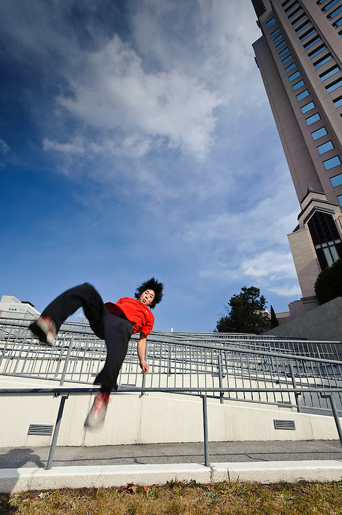 """Traceur (parkour practitioner) """"Yutaro"""" executing a flip. Practicing Parkour in Odaiba, Tokyo, Japan, January 27, 2012. Parkour is a modern method of physical training, also known as freerunning. It was founded in France in the 1990s. There is a small group of around 50 parkour practitioners in Tokyo."""