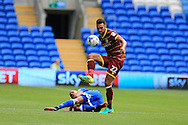 Steven Caulker of Queens Park Rangers gets to the ball ahead of Frederic Gounongbe of Cardiff city.  EFL Skybet championship match, Cardiff city v Queens Park Rangers at the Cardiff city stadium in Cardiff, South Wales on Sunday 14th August 2016.<br /> pic by Andrew Orchard, Andrew Orchard sports photography.