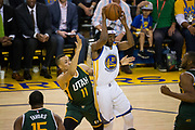 Golden State Warriors guard Ian Clark (21) passes the ball against the Utah Jazz during Game 1 of the Western Conference Semifinals at Oracle Arena in Oakland, Calif., on May 2, 2017. (Stan Olszewski/Special to S.F. Examiner)