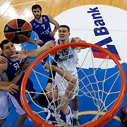Anadolu Efes's Milko Bjelica (2ndL) and Zalgiris Kaunas's Robertas Javtokas (C) Edgaras Ulanovas (R) during their Turkish Airlines Euroleague Basketball Group A Round 3 match Anadolu Efes between Zalgiris Kaunas at Abdi ipekci arena in Istanbul, Turkey, Thursday, October 30, 2014. Photo by Aykut AKICI/TURKPIX