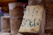 Stilton at a cheese stall. Borough Market is a thriving Farmers market near London Bridge. Saturday is the busiest day.