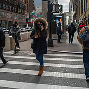 People mull about the city streets with face masks during the holiday season with Coronavirus (Covid-19) outbreak in Manhattan, New York on Tuesday, December 8, 2020. (Alex Menendez via AP)