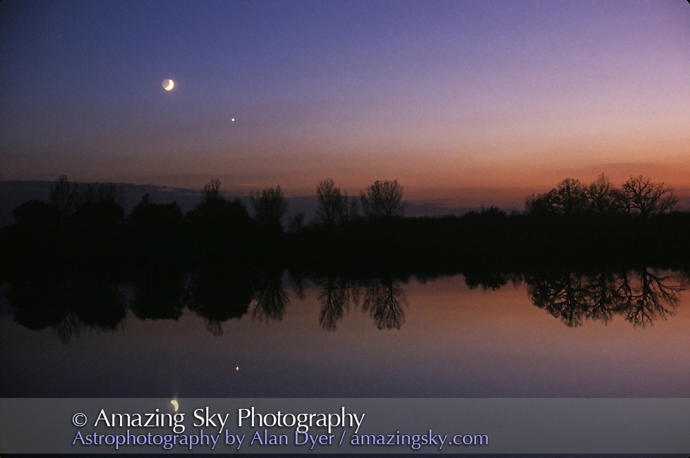Moon and Venus conjunction, October 28, 1992<br /> <br /> Photographed over Ottawa Lake, Wisconsin.<br /> <br /> 50mm lens f/2.8; exposure not recorded but about 1 second, ISO 100 slide film.